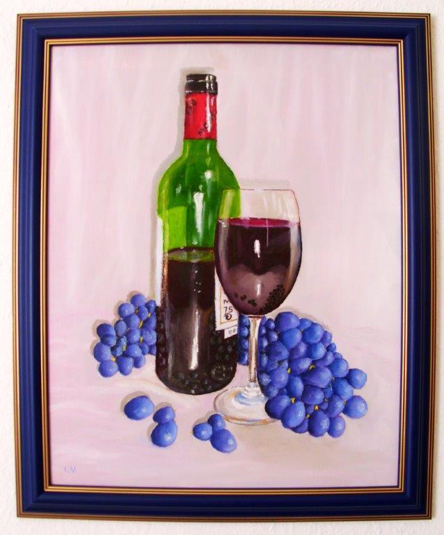 Die Flasche und Weintrauben