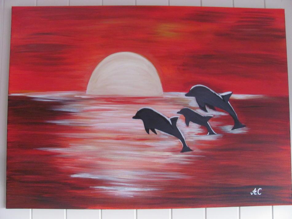 Delphine beim Sonnenuntergang