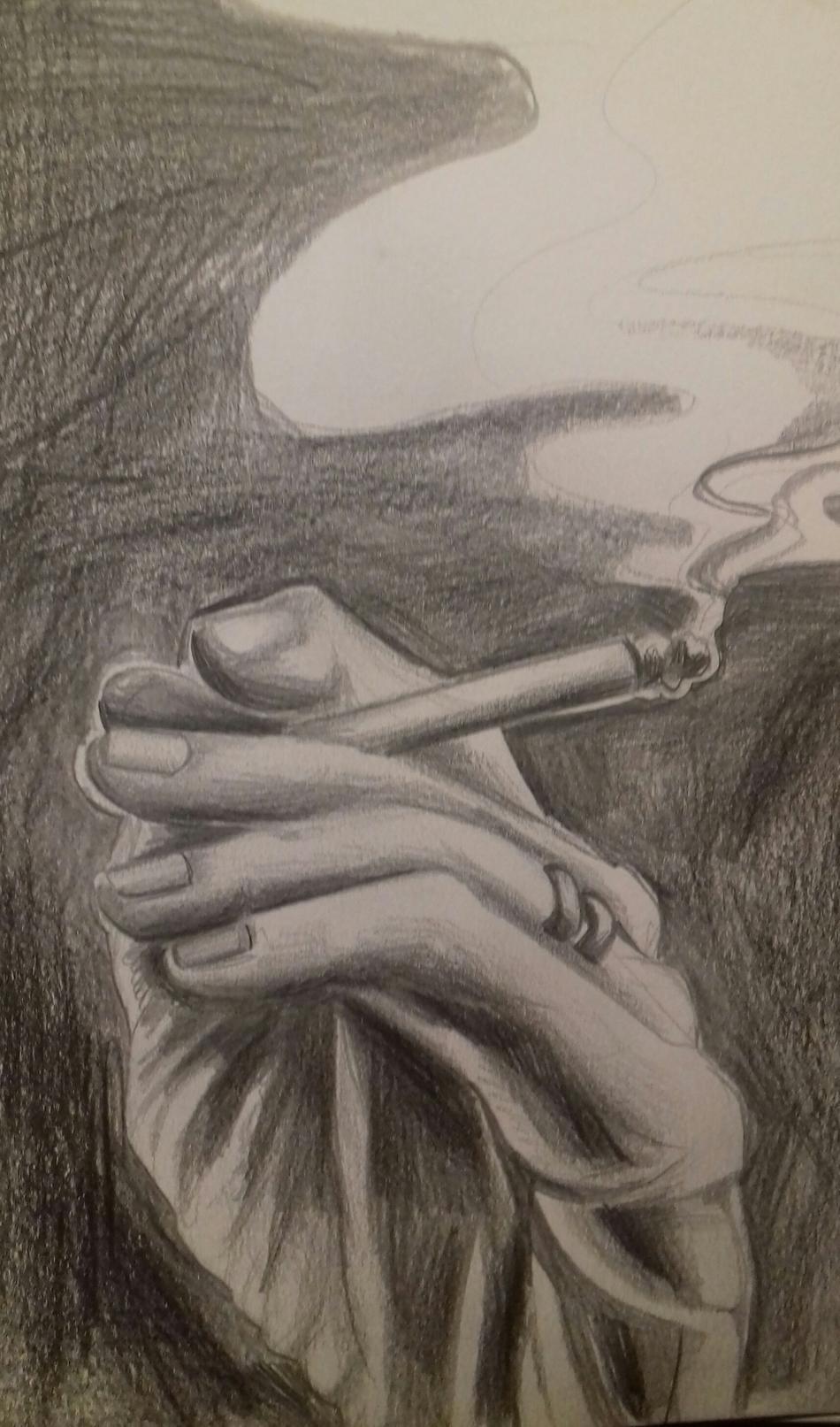 Hand eines Rauchers