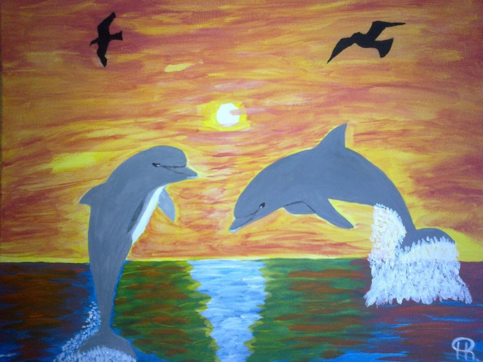 Delfine in der Abendsonne