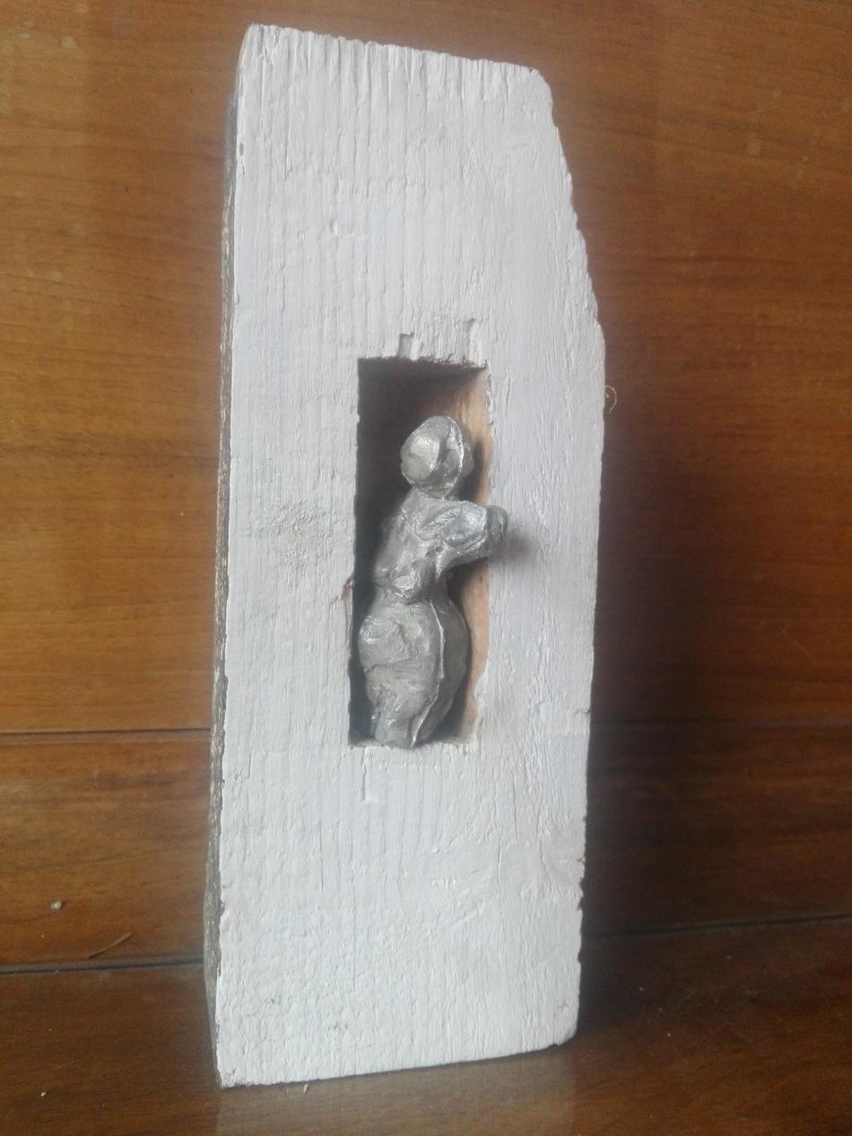 Bleitorso in Holzsteele