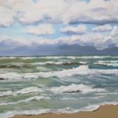 Lila Wolken und grünes Meer