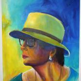Eine Frau mit dem Hut